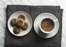 Cup of coffee with cookies on marble table stock photos