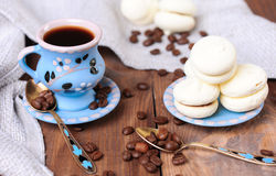 Cup of coffee with cookies. Cup of coffee with meringues closeup, selective focus Stock Photography
