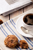 Cup of coffee with cookies and morning newspaper Royalty Free Stock Photo