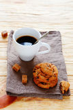 Cup of coffee and cookies on a napkin Stock Photos