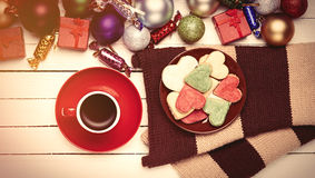 Cup of coffee and cookies near christmas toys. Stock Photography