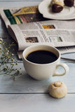 Cup of coffee, cookies and newspaper Stock Images