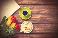 Cup of coffee and cookies with notebook Royalty Free Stock Images