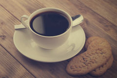 Cup of coffee with cookies Royalty Free Stock Images