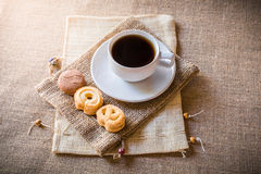 Cup of coffee and cookies on sackbag Royalty Free Stock Photography