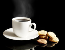Cup of coffee with cookies and saucer on black Royalty Free Stock Photo