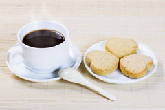 Cup of coffee and cookies in the shape of heart Stock Photo