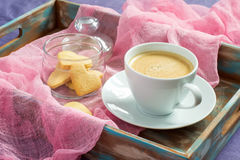 Cup of coffee and cookies in the shape of heart on tray. concept Stock Image
