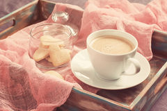 Cup of coffee and cookies in the shape of heart on tray. concept Stock Photo