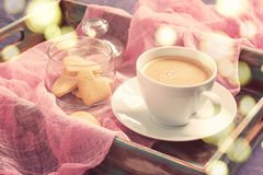 Cup of coffee and cookies in the shape of heart on tray. concept Stock Images