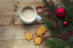 Cup of coffee with cookies in star shape and fir branches with c Stock Photos