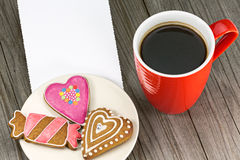 Cup of coffee and cookies on the table Stock Images