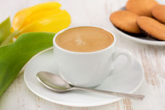 Cup of coffee, cookies and tulip Stock Photography