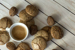 Cup of coffee, cookies, walnut and chocolate on wooden background Royalty Free Stock Photos