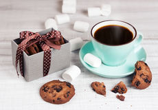 Cup coffee & cookies on white wood.Holiday pastel breackfast. Royalty Free Stock Photo