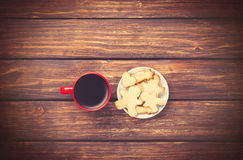 Cup of coffee and cookies on woden background. Royalty Free Stock Photo