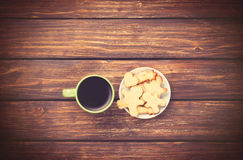 Cup of coffee and cookies on woden background. Stock Photo