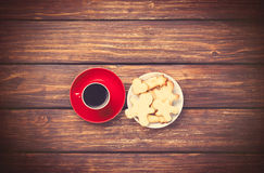 Cup of coffee and cookies on woden background. Stock Image
