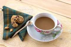 A cup of coffee and cookies on the wood. A cup of coffee and cookies chocolate chips on the wooden Stock Photography