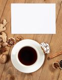 Cup of coffee and cookies on wooden background, spice and decoration, blank sheet for text, top view, retro style Stock Photos