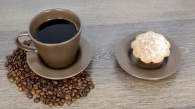 Cup of coffee and cookies on wooden table royalty free stock photos