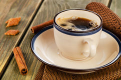 Cup of coffee and cookies on a  wooden table Stock Image
