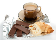 A cup of coffee, cornetto and pieces of chocolate Stock Photos
