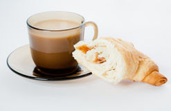 A cup of coffee and a cornetto Royalty Free Stock Images