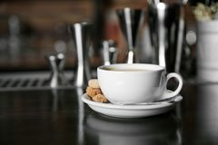 Cup of coffee on   counter. Cup of coffee on bar counter Royalty Free Stock Images