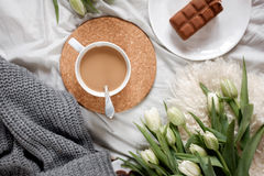A cup of coffee  on a cozy tablecloth Royalty Free Stock Photo