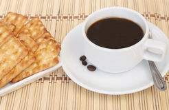 Cup of coffee and cracker Royalty Free Stock Photo