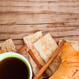 Cup of coffee, crackers and fresh croissant for breakfast Royalty Free Stock Image