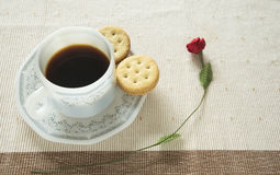 A cup of coffee and crackers. On the table Stock Images