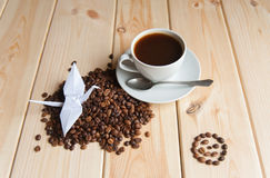 Cup of coffee with crane royalty free stock photos
