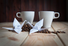 Cup of coffee with crane royalty free stock photo