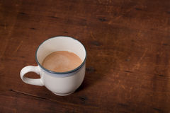 Cup of coffee with cream Royalty Free Stock Images