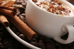 Cup of coffee with cream. And cinnamon Stock Photo