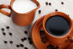 Cup of coffee and cream Stock Images