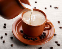 Cup of coffee and cream Stock Photos