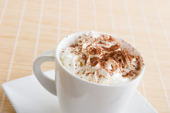 A cup of coffee with cream. And chocolate on top Stock Photos