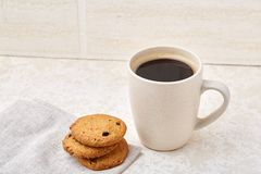 Cup of coffee and biscuit  on the white background, close-up, top view. Cup of coffee with cream and biscuit  on the white background. Concept image for Stock Images