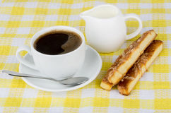 Cup of coffee, cream and biscuits Stock Image