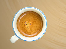 Cup of coffee. With cream on brown background Royalty Free Stock Image
