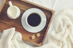 Cup of coffee, cream and brown sugar on wooden tray Royalty Free Stock Photos