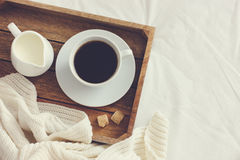 Cup of coffee, cream and brown sugar on wooden tray Stock Photography