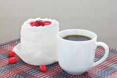 Cup of coffee and cream cake with cherries Stock Photography