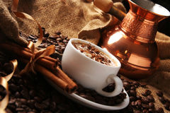 Cup of coffee with cream and cinnamon Royalty Free Stock Images