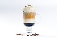Cup of coffee with cream and liqueur poured layers. Coffee cocktail Royalty Free Stock Images