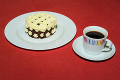 Cup of coffee with creamy dessert Royalty Free Stock Photo