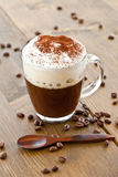 Cup of coffee with creamy milk foam Stock Photography